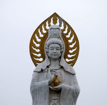 Statue of Guanyin goddess (Guanshiyin or Avalokitesvara), Goddess of Mercy. Dalian, China photo