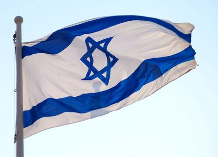 Flag of Israel, close up, against blue sky.   Stock Photo - 4213368