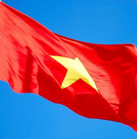 Flag of Socialist Republic Vietnam against blue sky. photo
