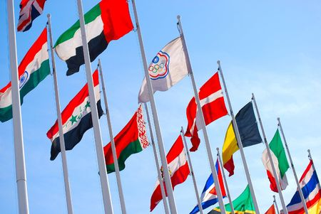olympic symbol: Flags against blue sky.