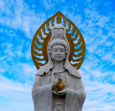 Statue of Guanyin goddess (Guanshiyin or Avalokitesvara), Goddess of Mercy. Dalian, China. photo