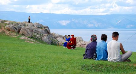 Shamans perform indigenous religion ceremony.  Olkhon island, Lake Baikal.  photo