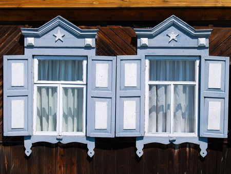 listvyanka: Part of the wooden house. Two windows.