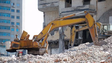 Old bulldozer. Destroyed building.  photo