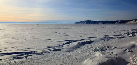 Frozen Lake Baikal. Sunset. photo