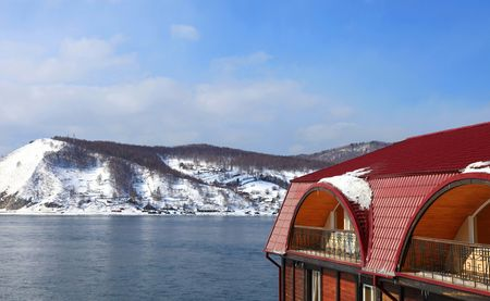 Part of house. Lake Baikal on background.  photo