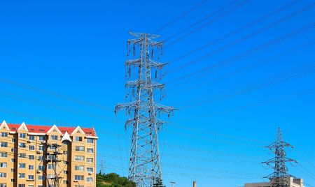 Apartment buildings. Group of electricity pylons. Dalian, China.  photo