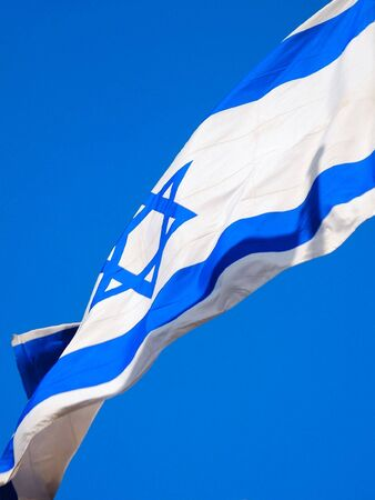 Flag of Israel against blue sky. Close up. Stock Photo - 6932402