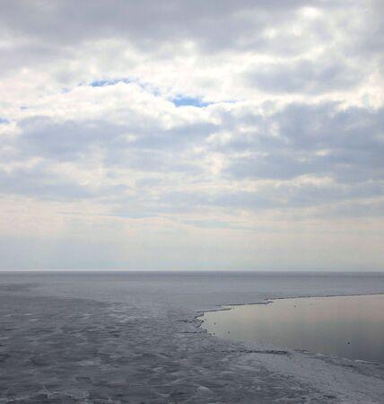 Frozen Lake Baikal in spring. Day. Nobody.  photo