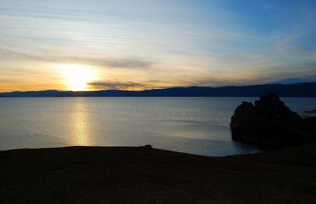 Sunset. Olkhon island. Lake Baikal. Mountains on horizon.  photo