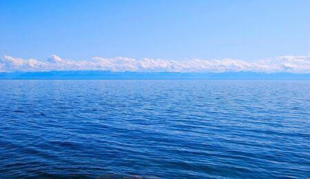 over the horizon: Calm Lake Baikal. Horizon over water. Nobody.