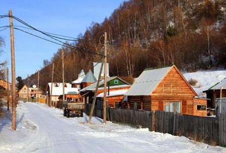 Listvianka settlement. Lake Baikal. Winter. Group of houses.  photo