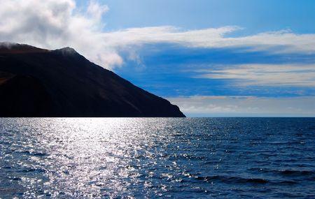 Lake Baikal. Storm. Autumn. Mountains on horizon.  photo