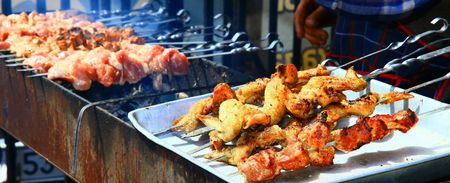 Shish preparation, meat on skewer. Close up. photo