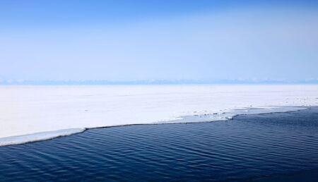 Frozen Lake Baikal, spring. Day. Nobody.  photo