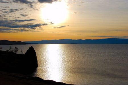 Sunset. Olkhon island. Lake Baikal. Mountains on horizon.  photo