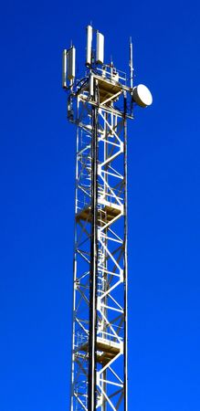 Part of the communication tower against blue sky.  photo
