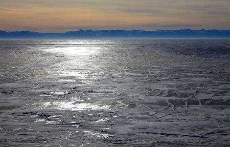 Frozen Lake Baikal in winter. Sunset. Nobody.  photo
