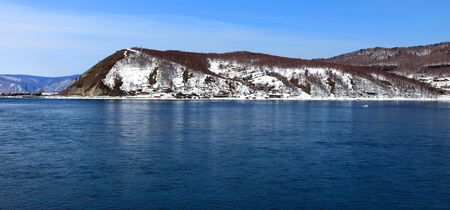 Lake Baikal. Spring. Day. Mountains on horizon.  photo