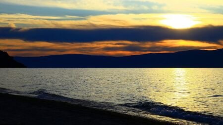Sunset. Lake Baikal. Olkhon island. Mountains on horizon.  photo
