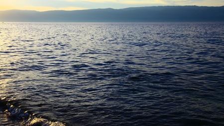 Twilight. Lake Baikal. Olkhon island. Mountains on horizon.  photo