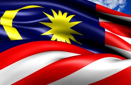 Flag of Malaysia against cloudy sky. Close up.