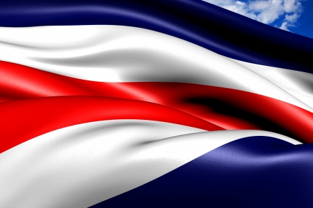 Flag of Costa Rica against cloudy sky. Close up.