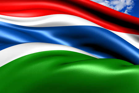 Flag of Gambia against cloudy sky. Close up.