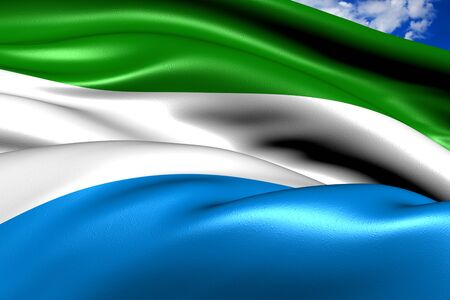 Flag of Sierra-Leone against cloudy sky. Close up. Stock Photo - 9120078