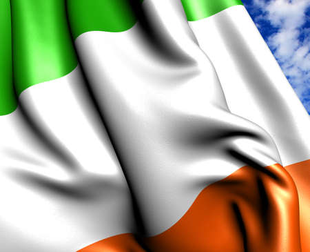 Flag of Ireland against cloudy sky. Close up.  photo