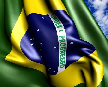 Flag of Brazil  against cloudy sky. Close up.  Stock Photo