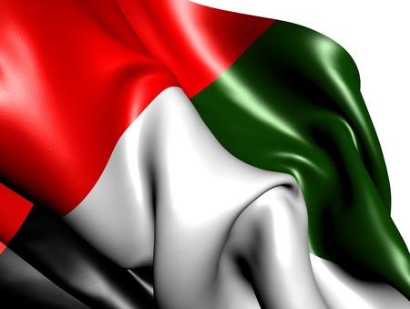 against white: Flag of United Arab Emirates against white background. Close up.