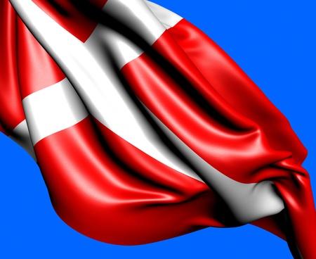 Flag of Denmark against blue background. Close up.  photo