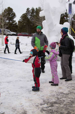 Breckenridge, Colorado  01/26/2013- Ice Sculpture Competition Fan Photo Stock Photo - 17838484