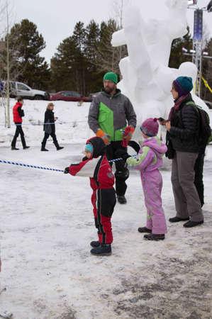 Breckenridge, Colorado  01/26/2013- Ice Sculpture Competition Fan Photo Stock Photo - 17838484