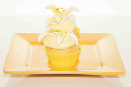Easter Cupcake On A Yellow Plate Stock Photo - 17743988