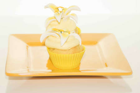 Easter Cupcake On A Yellow Plate Stock Photo - 17743979