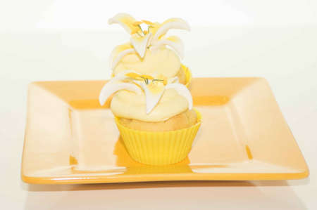 the feast of the passover: Easter Cupcake On A Yellow Plate Stock Photo