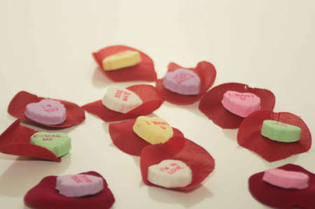 Valentine s Day Message Candies on Rose Petals Stock Photo - 17744100