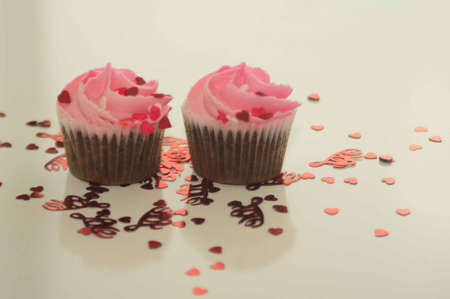 Valentine s Day Cupcakes and Heart Confetti Stock fotó