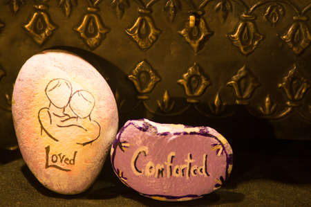 commotion: Emotion Rocks - Loved and Comforted Stock Photo