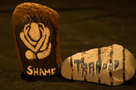 trapped: Emotion Rocks - Shame and Trapped Stock Photo