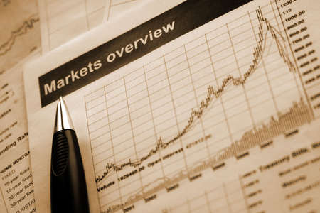 overview: closeup of a pen and markets overview report. sepia Stock Photo