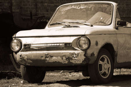 blasted: closeup of old abandoned blasted dirty cabriolet car