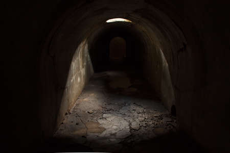 Skylight in the ceiling of the late tunnel and exit at the end of a dark underground