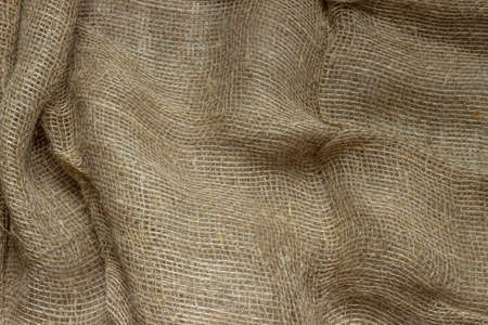 The structure of the threads of a natural burlap fabric close up. Stock Photo
