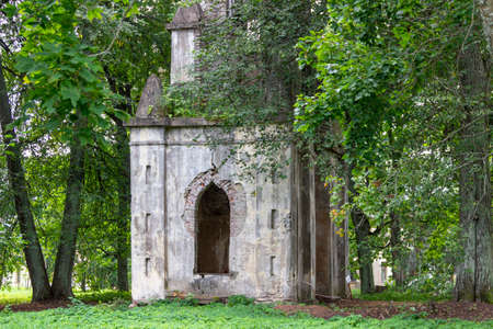 Taytsy, Leningrad region, Russia - September, 09, 2020: Gothic gate in the Demidovs' estate in the village of Taitsy, built at the end of the 18th century, is under restoration.