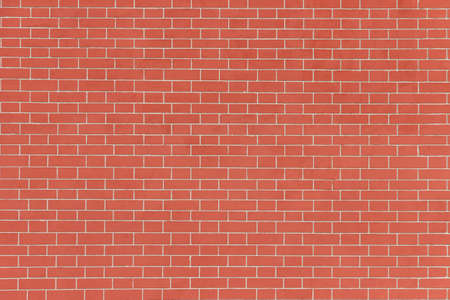 Surface of a red brick wall.