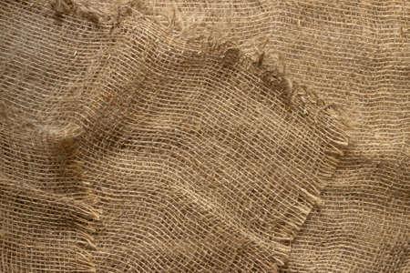 Texture of crumpled natural burlap close-up. Banque d'images