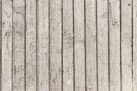 The surface of old wooden boards with peeling and weathered paint. Stock Photo